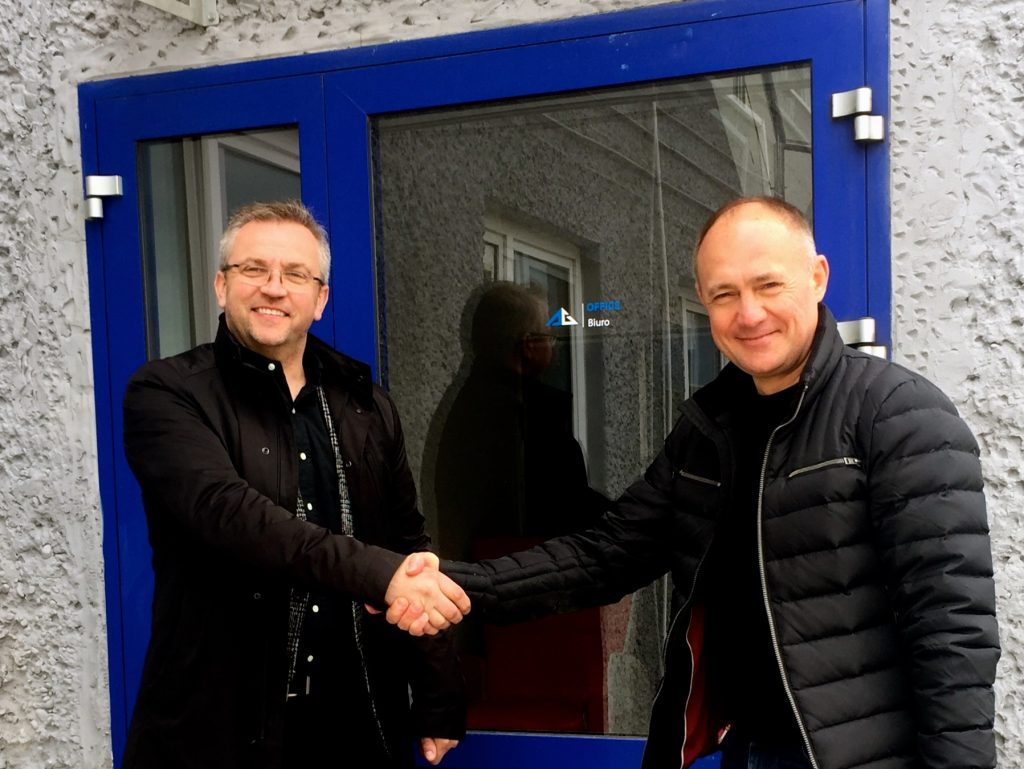 Partner business handshake / Piotr Wcisłek and Alexander Strizhak
